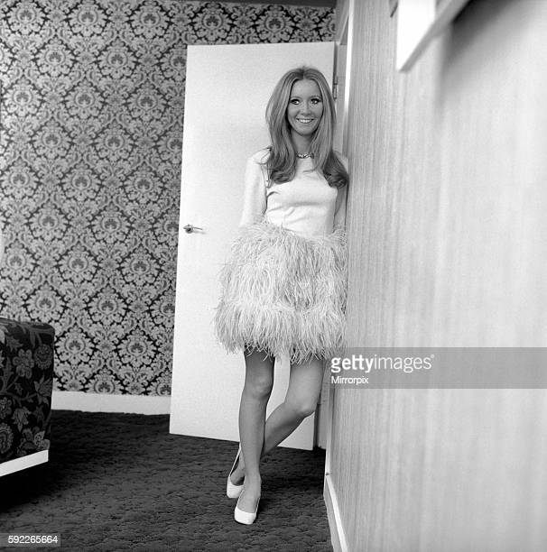 Presenter Clodagh Rodgers at her home in London with her cuddly Christmas present a truly giant Panda December 1969 Z11993002