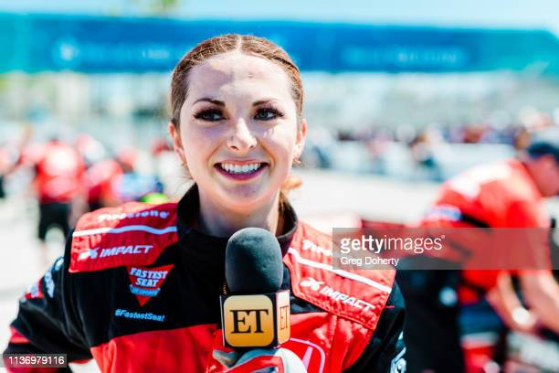 Entertainment Tonight reporter Lauren Zima after taking take a ride in the Honda 'Fastest Seat in Sports' with Racing Legend Mario Andretti at the...
