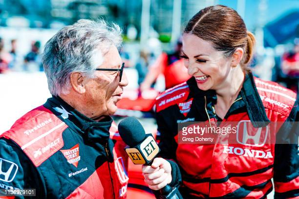 Entertainment Tonight reporter Lauren Zima interviews Mario Andretti before taking a ride in the Honda 'Fastest Seat in Sports' with Racing Legend...
