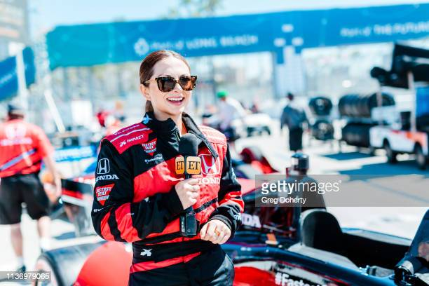 Entertainment Tonight reporter Lauren Zima prepares to take a ride in the Honda 'Fastest Seat in Sports' with Racing Legend Mario Andretti at the...