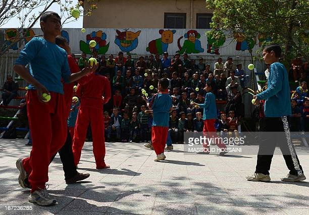 Entertainment-Afghanistan-circus,FEATURE by Simon Martin In this picture taken on April 21 Afghan children from the Mobile Mini Circus for Children...