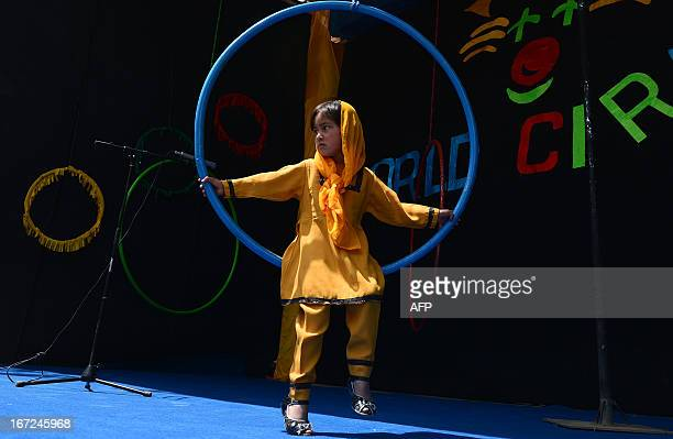 Entertainment-Afghanistan-circus,FEATURE by Simon Martin In this picture taken on April 21 a child plays as Afghan children from the Mobile Mini...