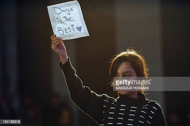 EntertainmentAfghanistanmusicpoliticsunrestFOCUS by Katherine Haddon This photo taken on November 24 2011 shows a young Afghan girl holding up a sign...
