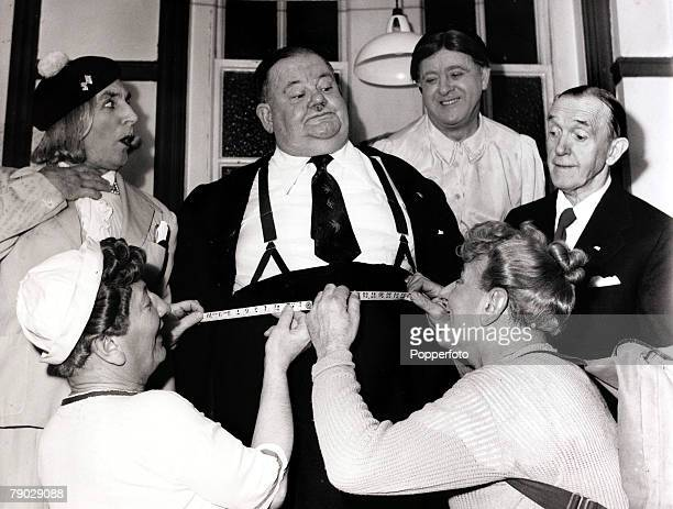 Entertainment/Comedy England 22nd February 1952 Britain's 'Crazy Gang' comedians measure Oliver Hardy's waist watched by his partner Stan Laurel at a...