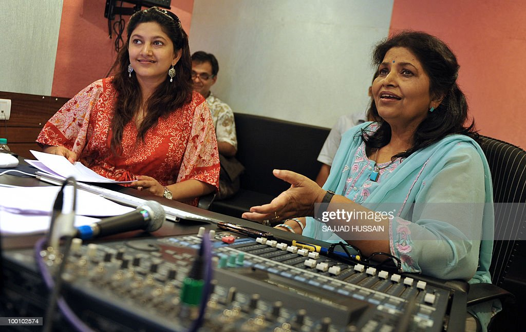 Entertainment-India-film-industry-US-Hollywood,FEATURE by Phil Hazlewood Indian voice artiste Mona Shetty (L) sits with her mother Leela Ghosh at their dubbing studio in Mumbai on May 12, 2010. The dubbing business is taking off in India with the increasing popularity of Hollywood films among domestic audiences, with analysts seeing it as a key emerging market for US films. Shetty, who runs a dubbing studio with her mother in the north of India's entertainment capital, has given her voice to some of Hollywood's most bankable female stars, like Angelina Jolie, Drew Barrymore, Cameron Diaz and Catherine Zeta-Jones. AFP PHOTO/Sajjad HUSSAIN