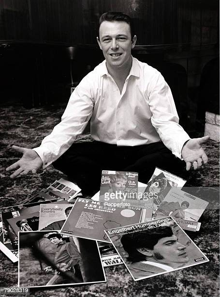 Entertainment/Music 7th December 1967 Pop music composer Les Reed sits amongst some of the records he composed