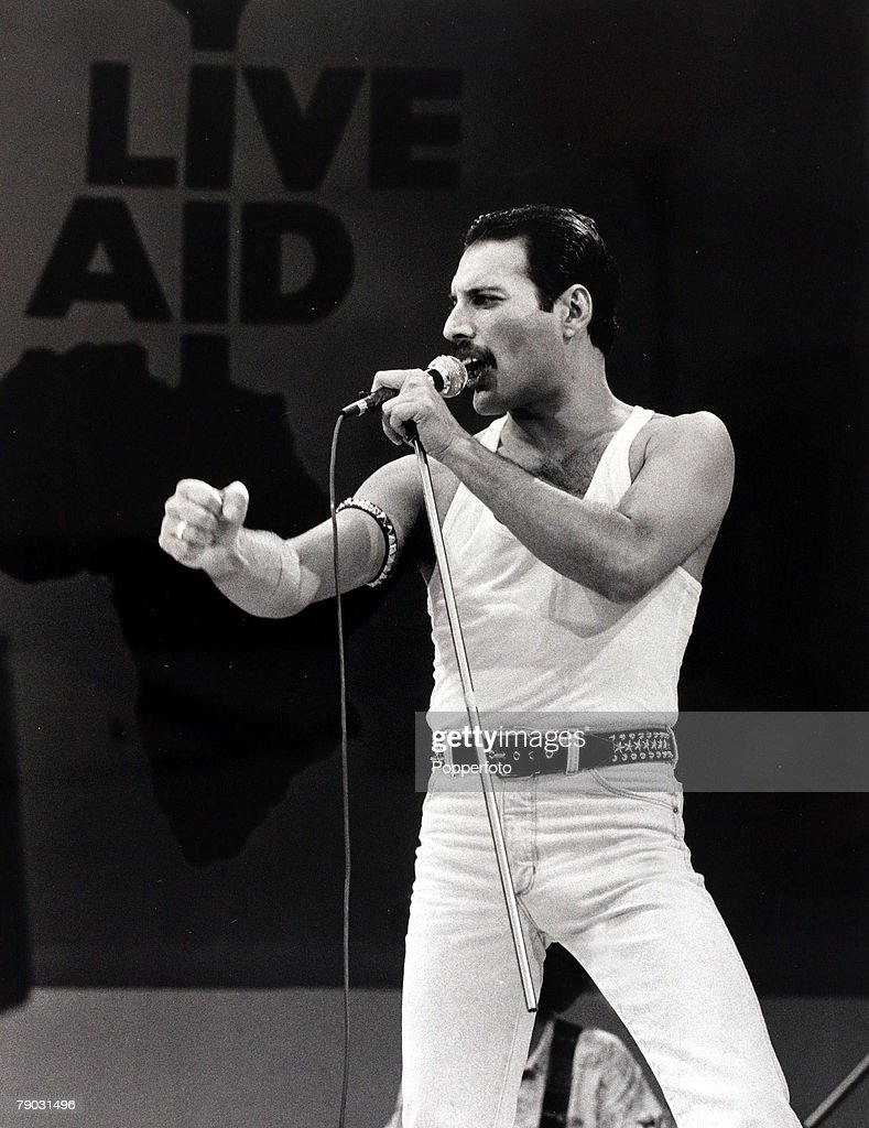 Entertainment/Music, Live Aid Concert, Wembley, London, England, 13th July 1985, Freddie Mercury of the rock group 'Queen' is pictured performing at the charity concert
