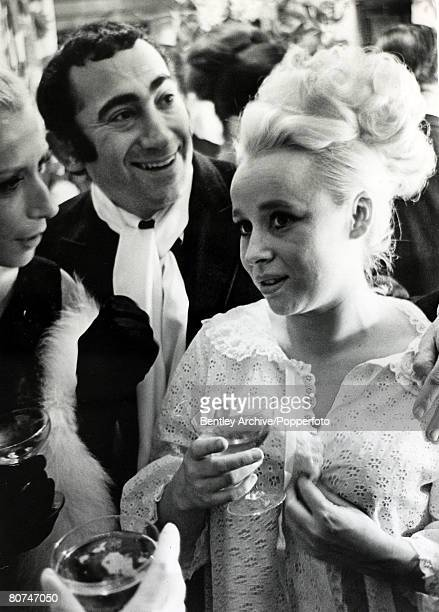 21st December 1965 English Composer and Lyricist Lionel Bart pictured with actress Barbara Windsor after his West End musical Twang had opened in...