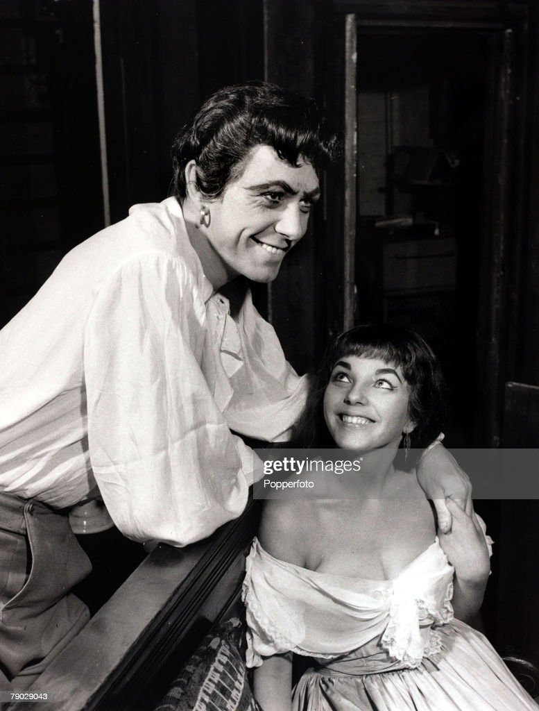 Entertainment/Theatre. England. 10th April 1952. British actress Joan Collins and Maxwell Reed pictured at a London theatre. : News Photo