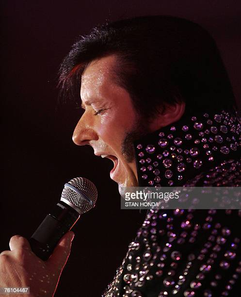 EntertainmentUSpeoplemusicElvis by Mira Oberman Elvis Presley impersonator Paul Rouse of England performs 14 August 2007 during the 'Images of the...