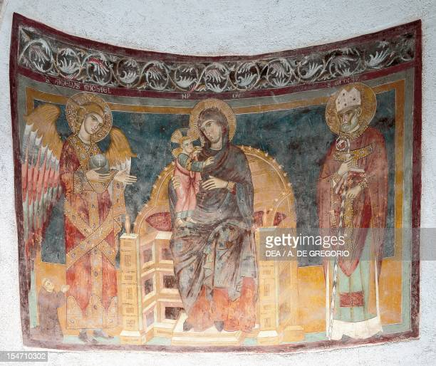 Enthroned Virgin and Child between the Archangel Michael and St Nicholas 12th century frescoes Abbey of St John in Venus Fossacesia Abruzzo Italy...