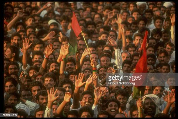 Enthused flag waving crowd of Pakistan People's Party ldr Bhutto's supporters at PPP election campaign rally in Punjab