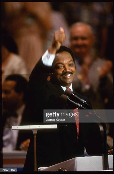 Enthused Rev Jesse Jackson giving thumbsup addressing Democratic Natl Convention as contender for presidential nomination