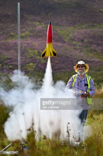 Enthusiast Jon Bonsar launches his rocket as they gather for International Rocket Week on August 25, 2021 in West Kilbride, Scotland. The IRW 2021 is...