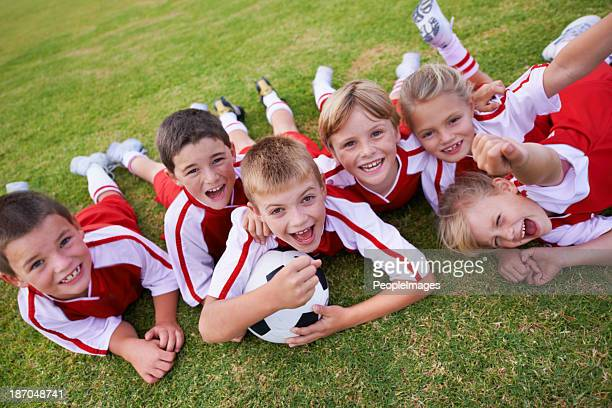 enthusiastic about winning this season - football team stock pictures, royalty-free photos & images