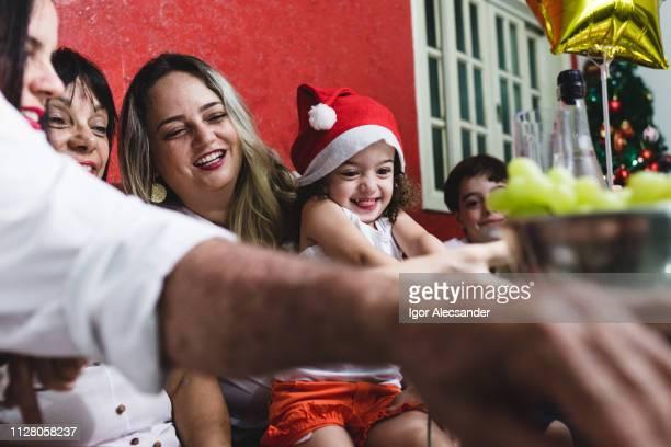 enthusiastic brazilian family on christmas eve - sentar se imagens e fotografias de stock