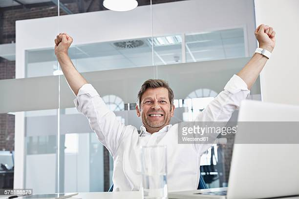 Enthusiastic businessman in office