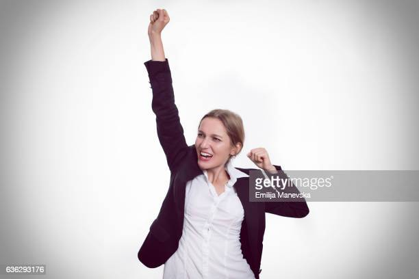 Enthusiastic businesswoman with one arm raised