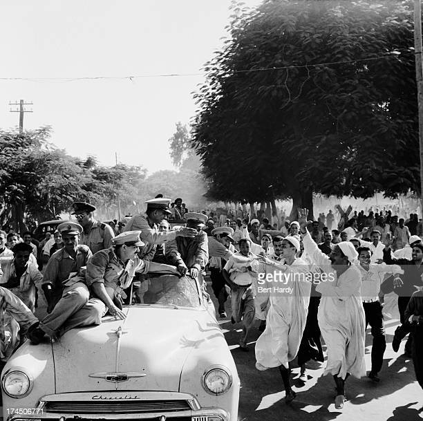 Enthusiastic Egyptian crowds surround General Muhammad Naguib on his progress through the Delta country in Egypt October 1952 The previous July...