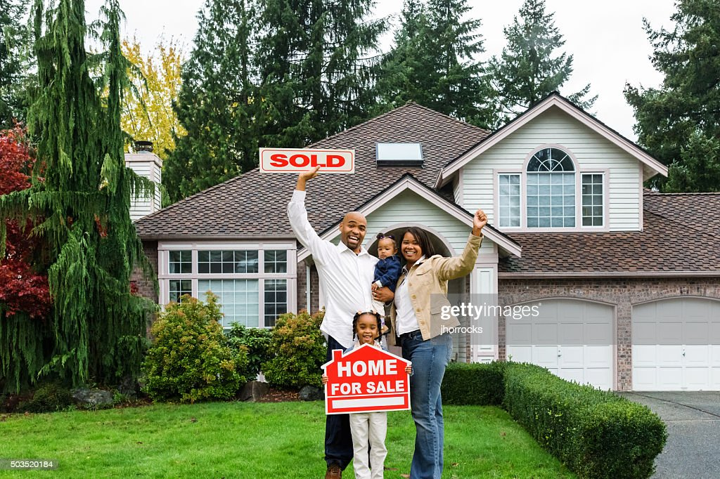 Enthusiastic Family with Home For Sale : Stock Photo