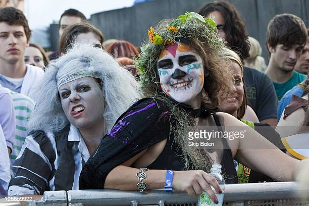 Enthusiastic fans in costume for Halloween at the 2010 Voodoo Experience on October 31 2010 in New Orleans Louisiana