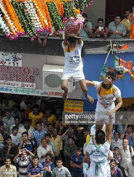 Enthusiastic 'Govindas' form human pyramids to break 'dahi handis' as they celebrated Janmashtami the 5239th birthday of one of Lord Vishnu's avatars