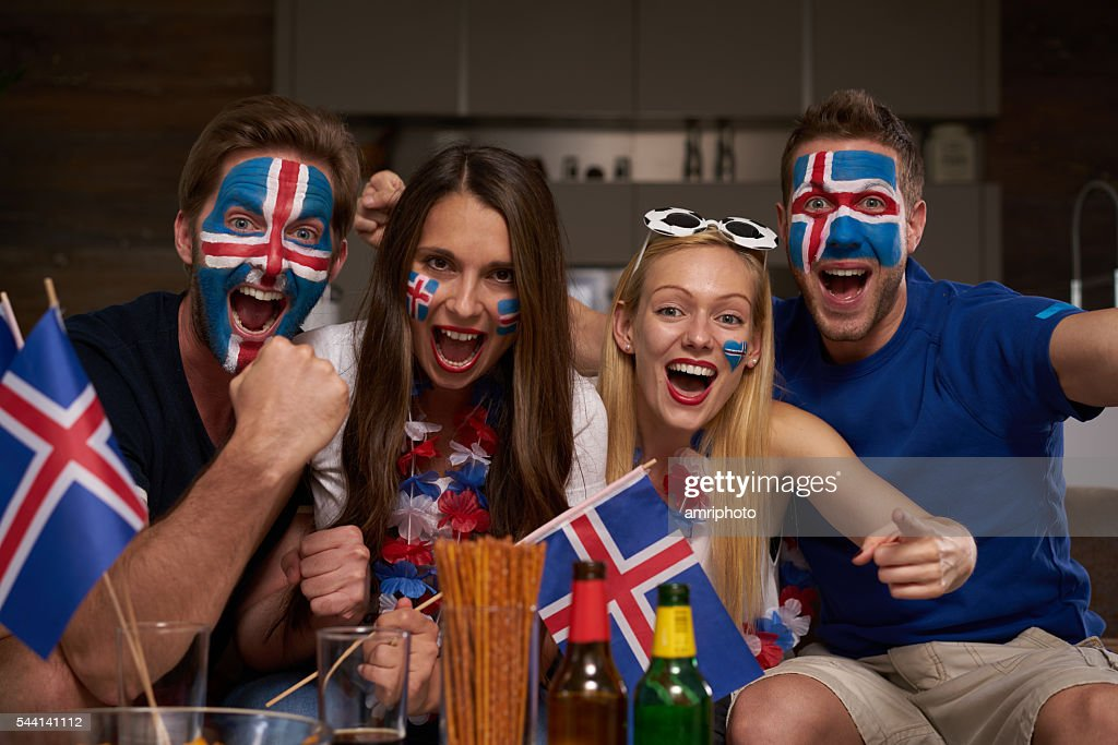 enthusiastic iceland football fans at home : Stock Photo