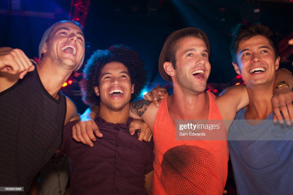 Enthusiastic men at concert : Stock Photo