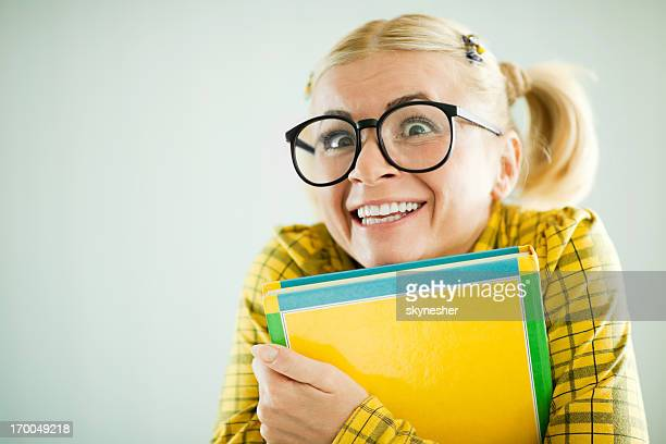 Enthusiastic nerd holding her notebooks