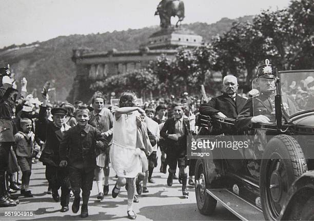 Enthusiastic school children running beside the car with the President Paul von Hindenburg Koblenz 23th July 1930 Photograph