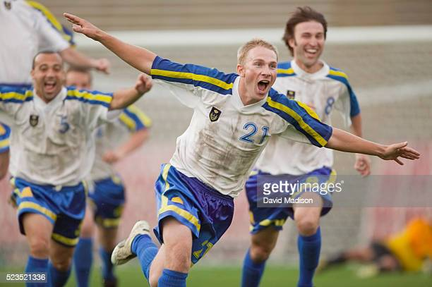 enthusiastic soccer player cheering - scoring a goal stock pictures, royalty-free photos & images