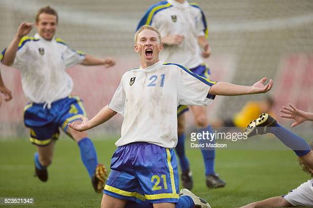 Enthusiastic Soccer Player Cheering