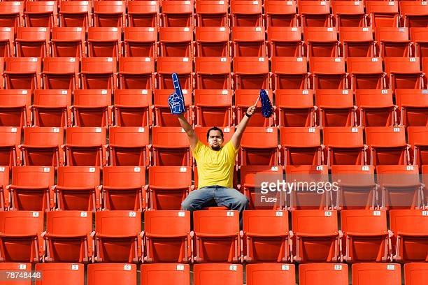 enthusiastic sports fan in stadium - bleachers stock pictures, royalty-free photos & images