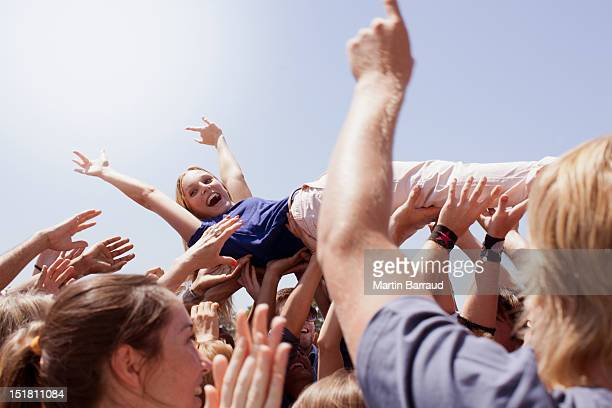 Enthusiastic woman crowd surfing