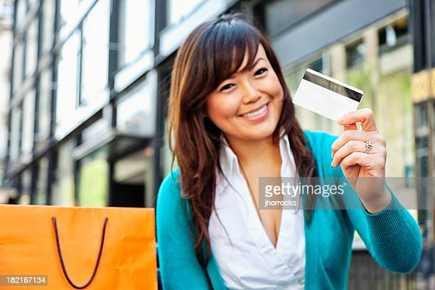 Enthusiastic Young Asian Woman with Credit Card