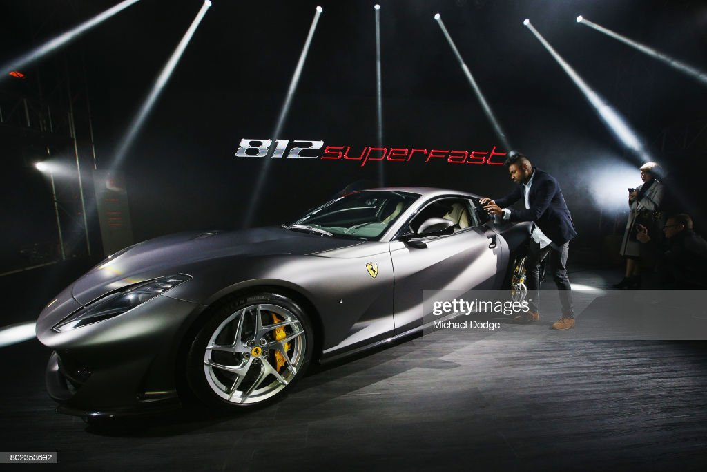Enthusiasts check out the new Ferrari 812 Superfast at its Australasian Premiere on June 28, 2017 in Melbourne, Australia. The 812 Superfast is the most powerful and fastest Ferrari in the carmakers history, reaching 0-100 km/h in just 2.9 seconds.