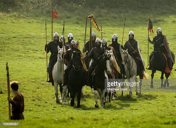 Enthusiasts dressed as Saxon and Norman warriors participate in a reenactment of the 1066 AD Battle of Hastings on October 9 2010 in Battle near...