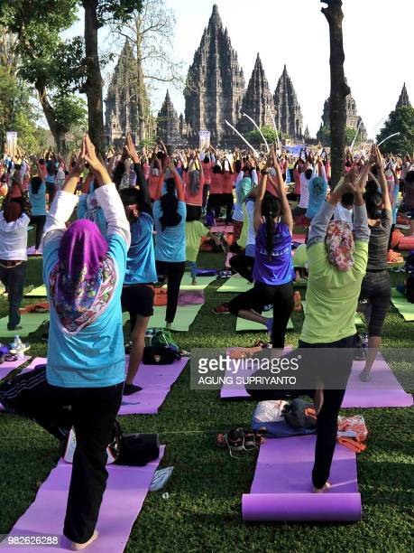 Enthusiasts perform a mass yoga session on the compounds of the 10th century Prambanan Temple the largest temple compound dedicated to Shiva in...