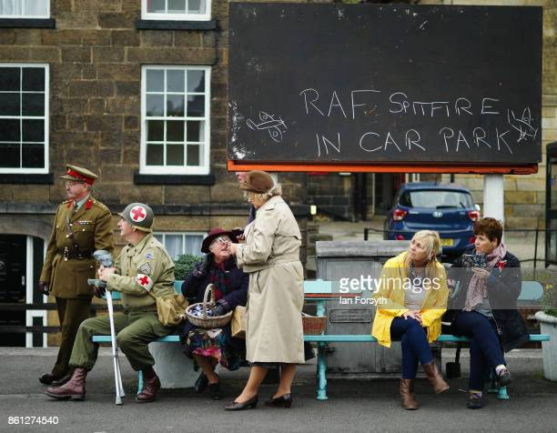 Enthusiasts wearing period clothing wait on the platform at Grosmont station during the North Yorkshire Moors Railway 1940's Wartime Weekend event on...
