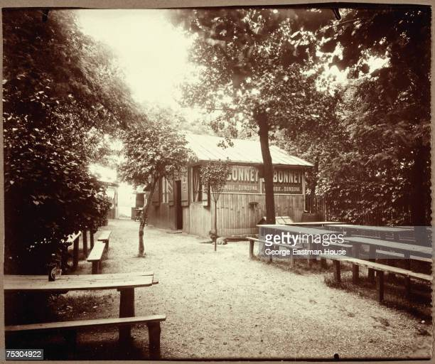 Entiled 'Porte de Menilmontant glacis de fortifications Guinguette ' the image shows a deserted outdoor drinking establishment with a series on...