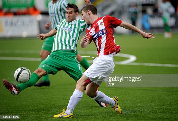 Entonio Pashaj of NK Olimpija Ljubljana in action against Thomas Kind Bendiksen of Tromsoe during round two of the Europa League qualifying match in...