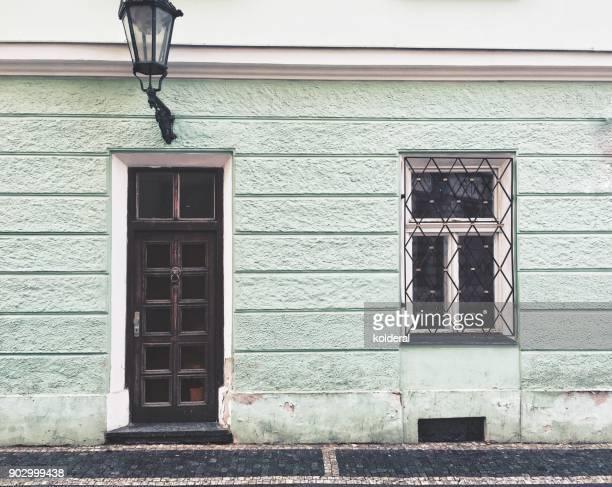 entrance and window of historic building in old city of prague - judiskt museum bildbanksfoton och bilder