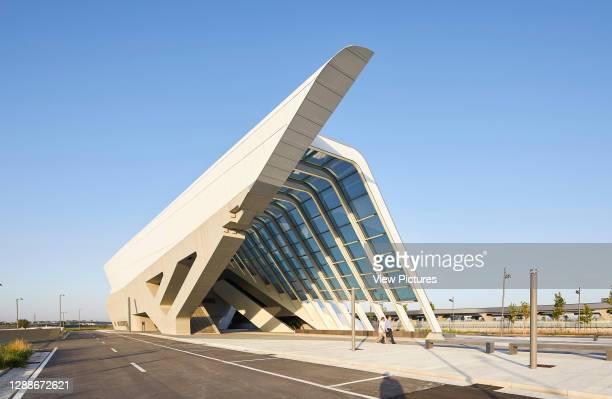 Entrance area on street side with trapezoidal reinforced concrete facade. Afragola Train Station Naples, Naples, Italy. Architect: Zaha Hadid...