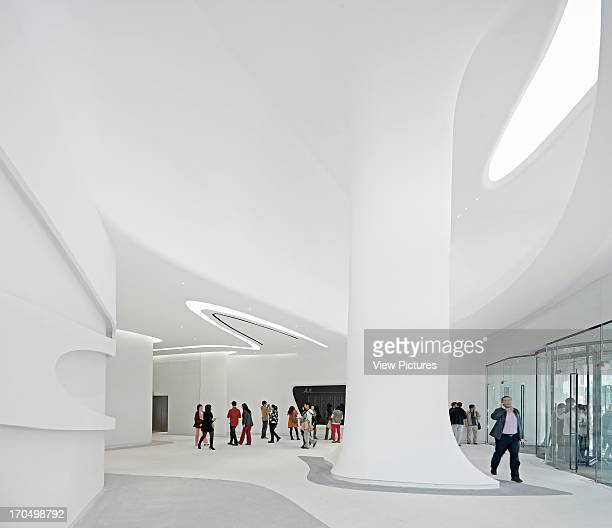 Entrance atrium with sculptural pillar Galaxy Soho Beijing China Architect Zaha Hadid Architects 2012