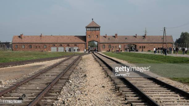 entrance building at auschwitz-birkenau concentration camp, poland - holocaust stock pictures, royalty-free photos & images