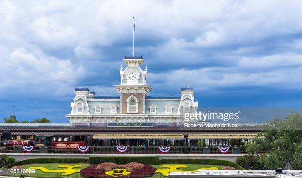 Entrance building of the Walt Disney's Magic Kingdom park during an overcast day. The famous place is a major tourist attraction in the state of...