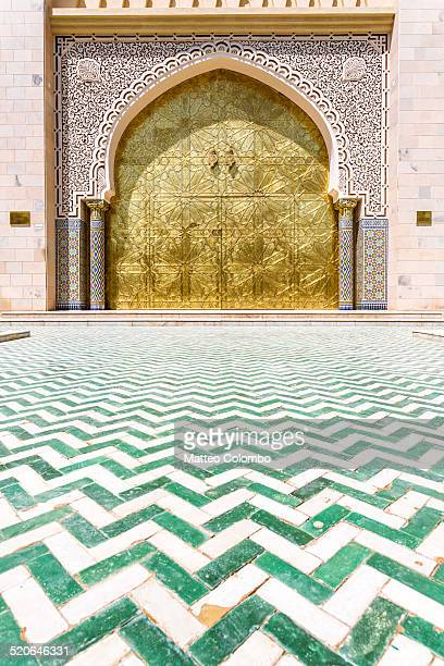 Entrance door to mosque and ornate floor, Oman