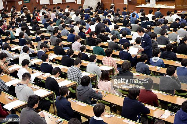 Entrance exam takers of the Tokyo University wait before the start on February 25, 2015 in Tokyo, Japan. Those wish to enter national universities in...