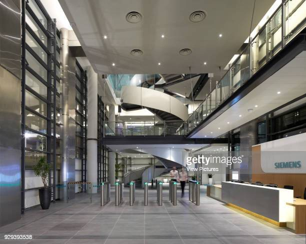 Entrance foyer with reception. Siemens Masdar, Abu Dhabi, United Arab Emirates. Architect: Sheppard Robson, 2014.