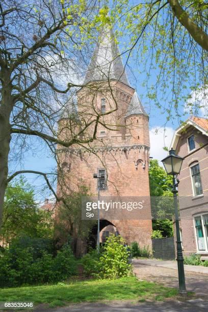 Entrance gate Drogenapstoren in the monumental fortified city wall in Zutphen in Gelderland, The Netherlands